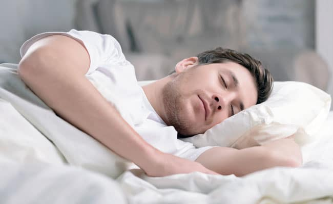 man sleeping on a comfortable mattress
